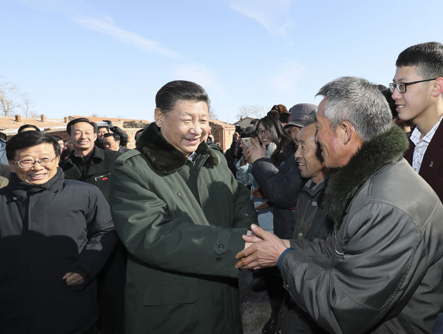 Chinese President Xi Jinping inspects a rural village in Zhangbei County, Zhangjiajie of north China's Hebei Province, on January 24, 2017. [Photo: Xinhua]