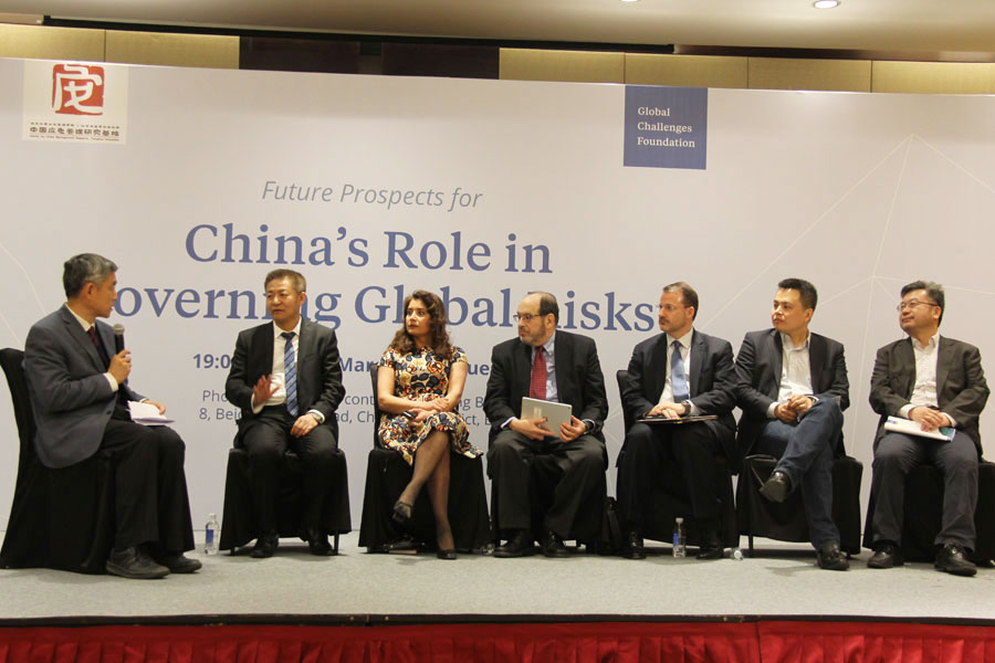 A panel discussion is held during a forum in Beijing talking about the most urgent global risks and China's role in global governance on Tuesday, March 14, 2017. [Photo: China Plus / Zhang Jin]
