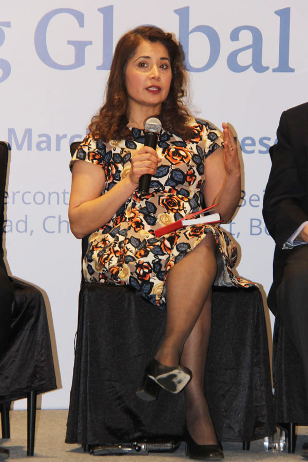 """Malini Mehra, Chief Executive of GLOBE International Secretariat and Ambassador of the """"Global Challenges Prize 2017: A New Shape"""" competition, speaks during a panel discussion during a forum held in Beijing talking about the most urgent global risks and China's role in global governance on Tuesday, March 14, 2017. [Photo: China Plus / Zhang Jin]"""