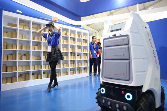 """""""Xiao G"""" (""""Little G"""") delivery robot developed by Cainiao Network, a logistics company launched by Chinese e-commerce giant Alibaba Group [Photo: cqnews.net]"""