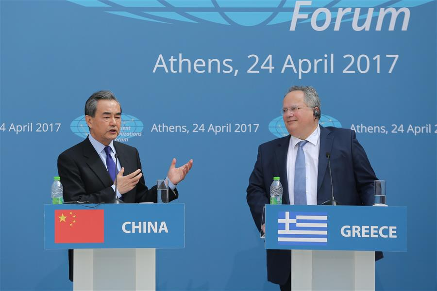 Chinese Foreign Minister Wang Yi (L) and Greek Foreign Minister Nikos Kotzias attend the first ministerial meeting of the Ancient Civilization Forum in Athens, Greece, on April 24, 2017. [Photo: Xinhua]