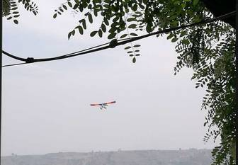 The photo taken by a netizen shows the recreational airplane before crashing into a tree, killing two people and injuring another on April 30, 2017, in north China's Shanxi Province. [Photo: Wechat]