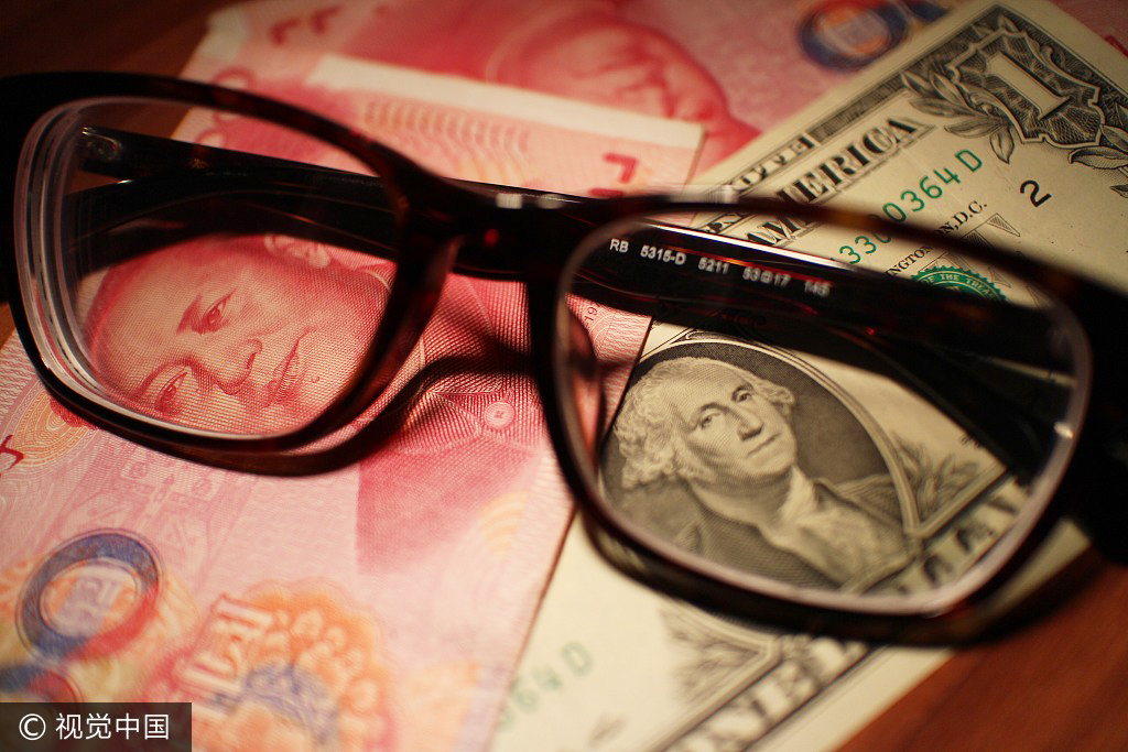 Chinese currency yuan and U.S. dollars [File Photo: VCG]