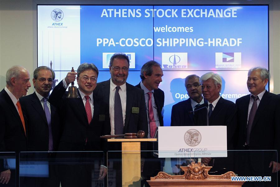 President of Cosco Shipping Wan Min (3rd L) rings the bell at the opening session, marking the debut at Greece's largest port at the Athens Stock Exchange in Athens, Greece, Aug. 10, 2016.[Photo: Xinhua]